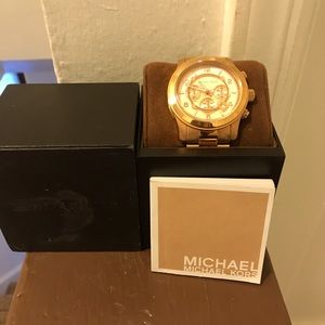 Rose gold women's Micheal Kors watch